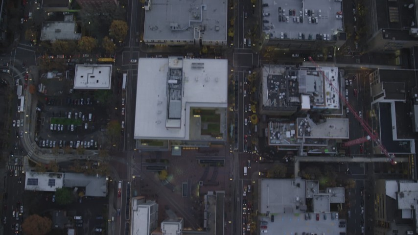 6K stock footage aerial video of a bird's eye view of SW and 5th and 6th Avenue at twilight, revealing SW Broadway, Downtown Portland, Oregon Aerial Stock Footage | AX155_225