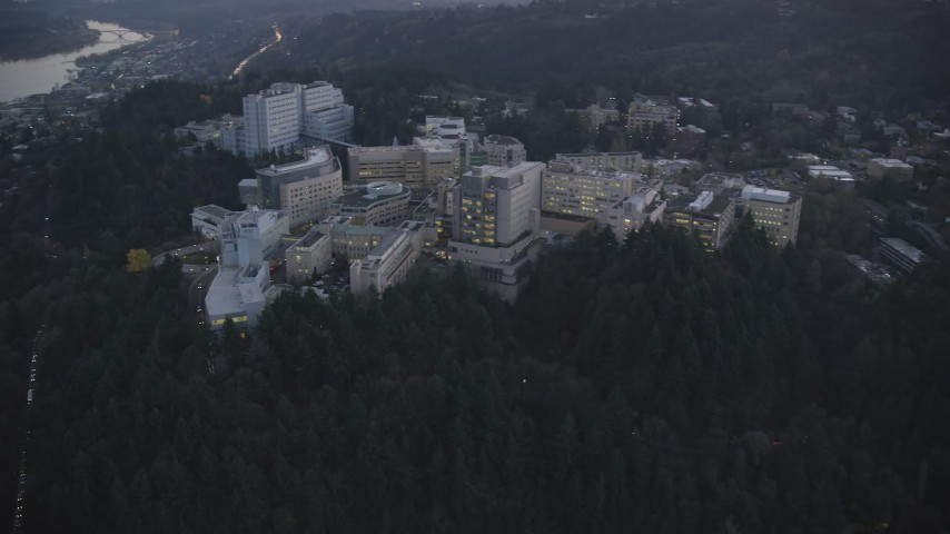 6K stock footage aerial video approaching Oregon Health and Science University in the hills at twilight, Portland, Oregon Aerial Stock Footage | AX155_226
