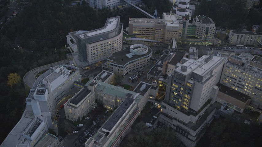 6K stock footage aerial video flying by and away from the Oregon Health and Science University in the hills at twilight, Portland, Oregon Aerial Stock Footage | AX155_227