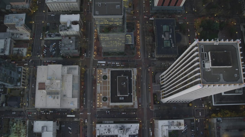 6K stock footage aerial video of a bird's eye view of buildings between SW 6th Avenue SW 5th Avenue at twilight, reveal Pioneer Courthouse, Downtown Portland, Oregon Aerial Stock Footage | AX155_231