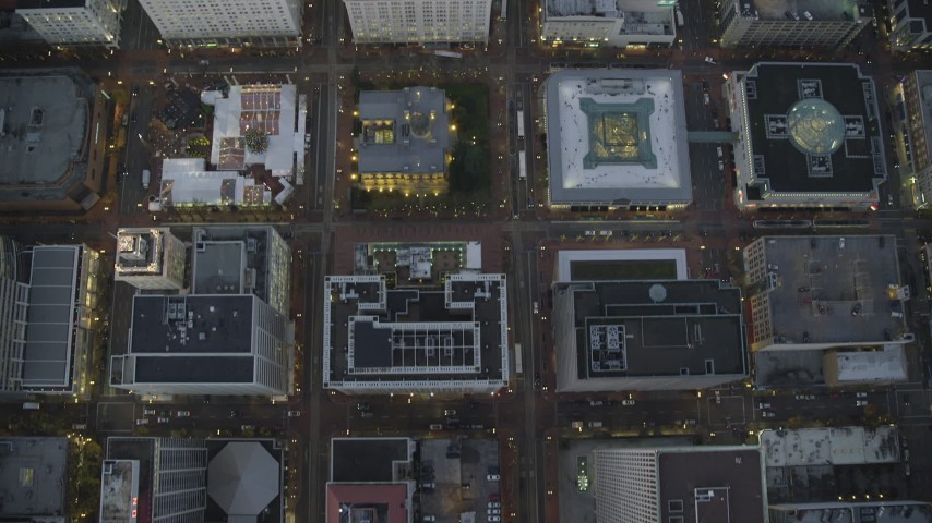 6K stock footage aerial video of a bird's eye view of buildings between SW 6th Avenue SW 5th Avenue at twilight near Pioneer Courthouse, Downtown Portland, Oregon Aerial Stock Footage | AX155_232