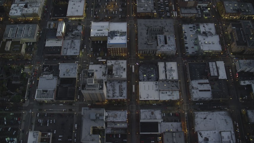 6K stock footage aerial video of a bird's eye view follow NW 5th Avenue at twilight, reveal US Bancorp Tower, Downtown Portland, Oregon Aerial Stock Footage | AX155_238