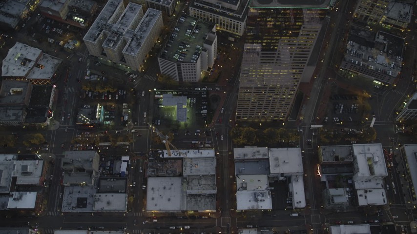 6K stock footage aerial video of a bird's eye view follow SW 5th Avenue at twilight past US Bancorp Tower, Downtown Portland, Oregon Aerial Stock Footage | AX155_239