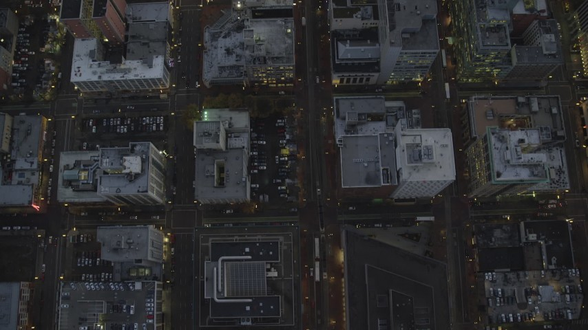 6K stock footage aerial video of a bird's eye view follow SW 5th Avenue at twilight and reveal Pioneer Place and Courthouse, Downtown Portland, Oregon Aerial Stock Footage | AX155_240