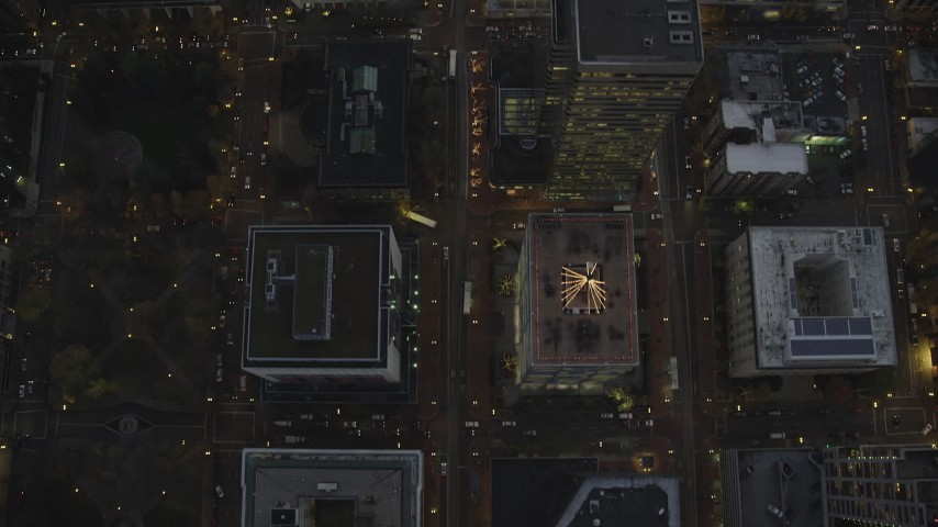 6K stock footage aerial video of a bird's eye view follow SW 5th Avenue at twilight and reveal Wells Fargo Center, Downtown Portland, Oregon Aerial Stock Footage | AX155_242