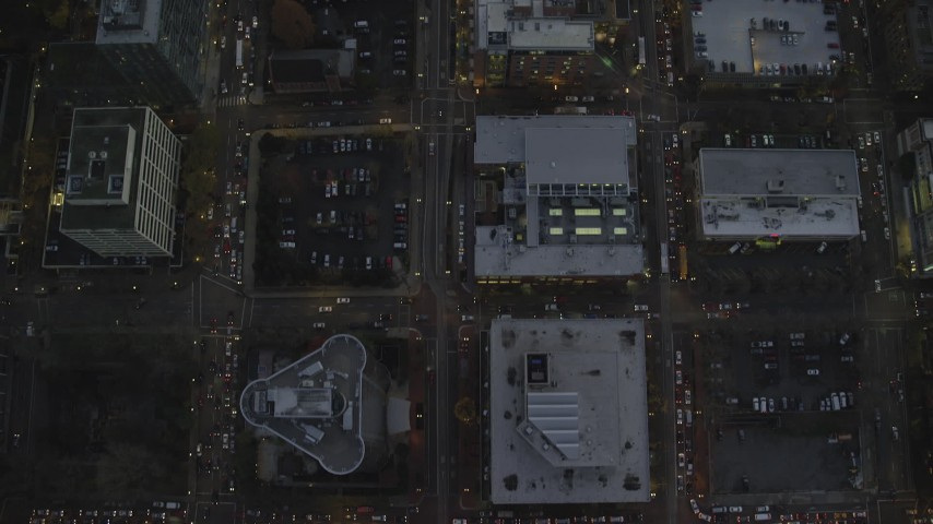 6K stock footage aerial video of a bird's eye view follow SW 5th Avenue at twilight through Downtown Portland, Oregon Aerial Stock Footage | AX155_243