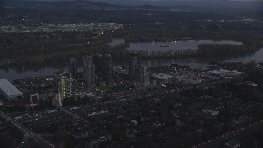 6K stock footage aerial video approaching South Waterfront high-rise condo complexes by the Willamette River in Portland, Oregon, twilight Aerial Stock Footage | AX155_246