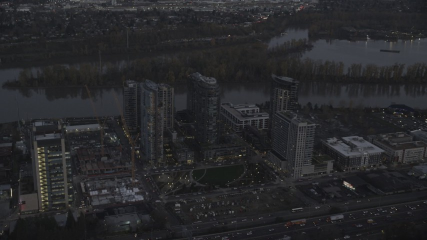 6K stock footage aerial video approaching Mirabella Portland and John Ross Tower, South Waterfront, Portland, Oregon, twilight Aerial Stock Footage   AX155_247