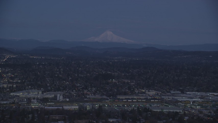 6K stock footage aerial video of Mount Hood at twilight, seen from a train yard and neighborhoods in Southeast Portland, Oregon Aerial Stock Footage | AX155_248