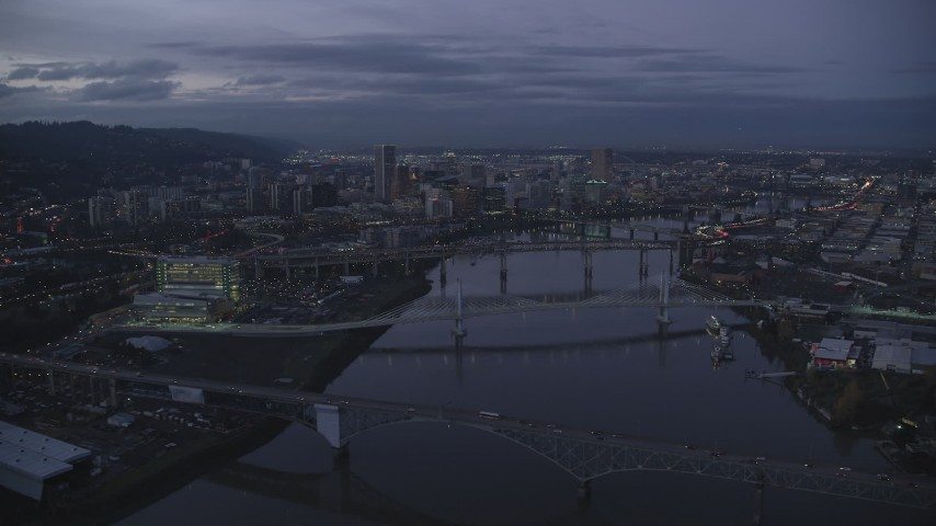 6K stock footage aerial video of Downtown skyscrapers and bridges over the Willamette River at twilight, Downtown Portland, Oregon Aerial Stock Footage | AX155_249