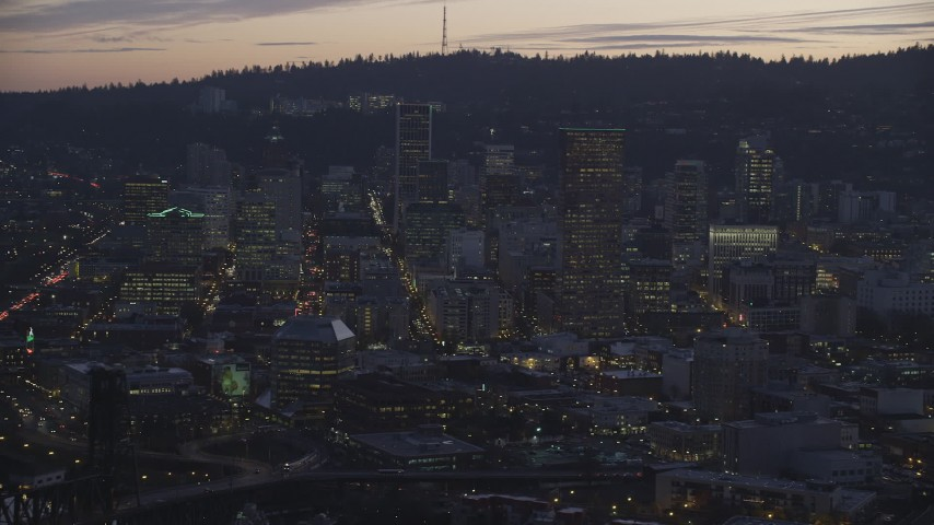 6K stock footage aerial video of US Bancorp Tower and downtown skyscrapers at twilight, Downtown Portland, Oregon Aerial Stock Footage | AX155_258