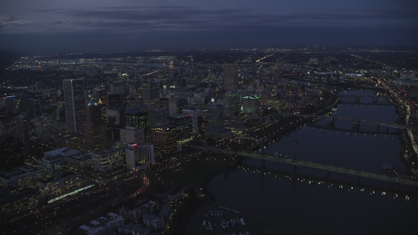 6K stock footage aerial video of Downtown Portland's cityscape beside the Willamette River at twilight, Oregon Aerial Stock Footage | AX155_268