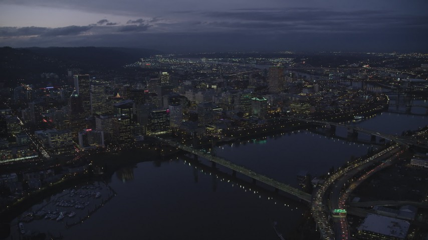 6K stock footage aerial video of Downtown Portland's cityscape, Hawthorne Bridge, and the Willamette River at twilight, Oregon Aerial Stock Footage | AX155_269