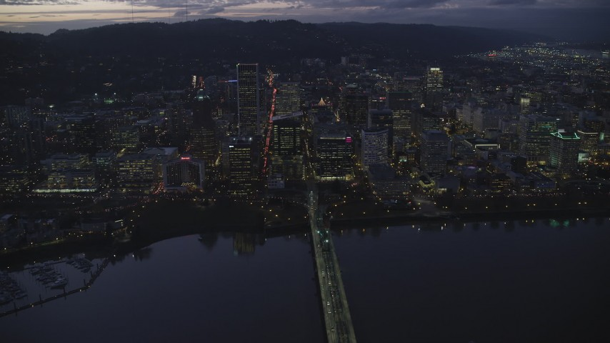 6K stock footage aerial video crossing Hawthorne Bridge to approach Downtown Portland's skyscrapers at twilight, Oregon Aerial Stock Footage | AX155_270