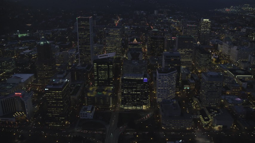 6K stock footage aerial video following SW Main Street through Downtown Portland at night, Oregon Aerial Stock Footage | AX155_271