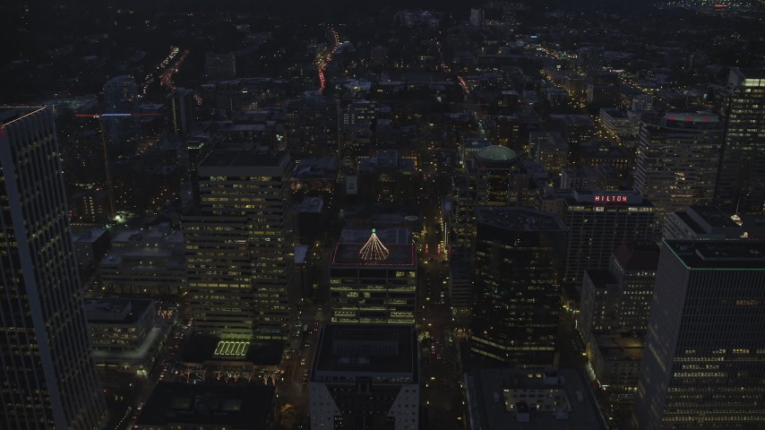 6K stock footage aerial video following SW Main Street over Downtown Portland at night, Oregon Aerial Stock Footage | AX155_272