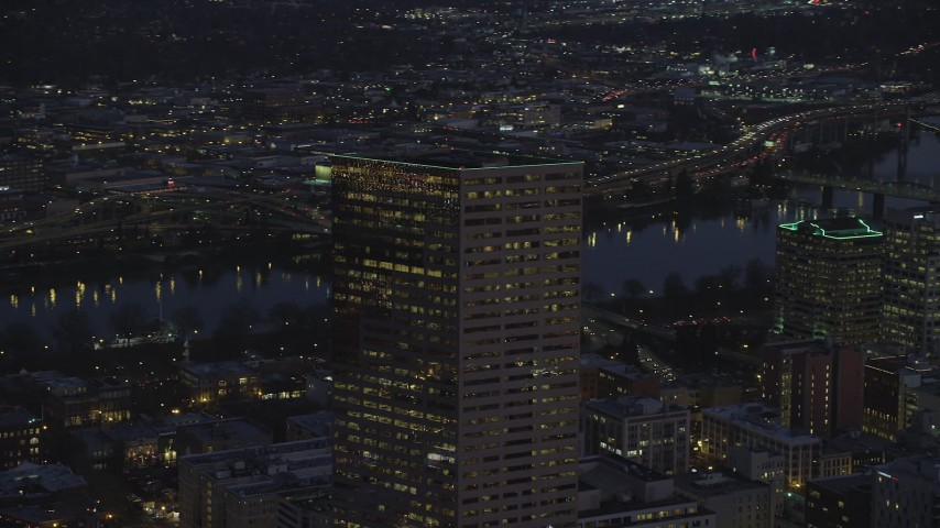 6K stock footage aerial video orbiting the top of US Bancorp Tower at night in Downtown Portland, Oregon Aerial Stock Footage | AX155_275