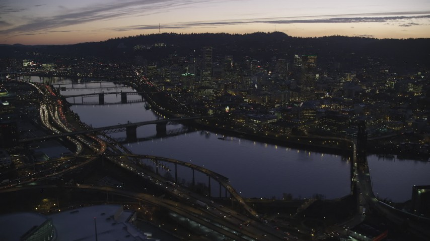 Willamette River, bridges and Downtown Portland, Oregon at sunset Aerial Stock Footage | AX155_277