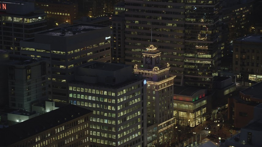 6K stock footage aerial video tracking the top of Jackson Tower at night in Downtown Portland, Oregon Aerial Stock Footage | AX155_283