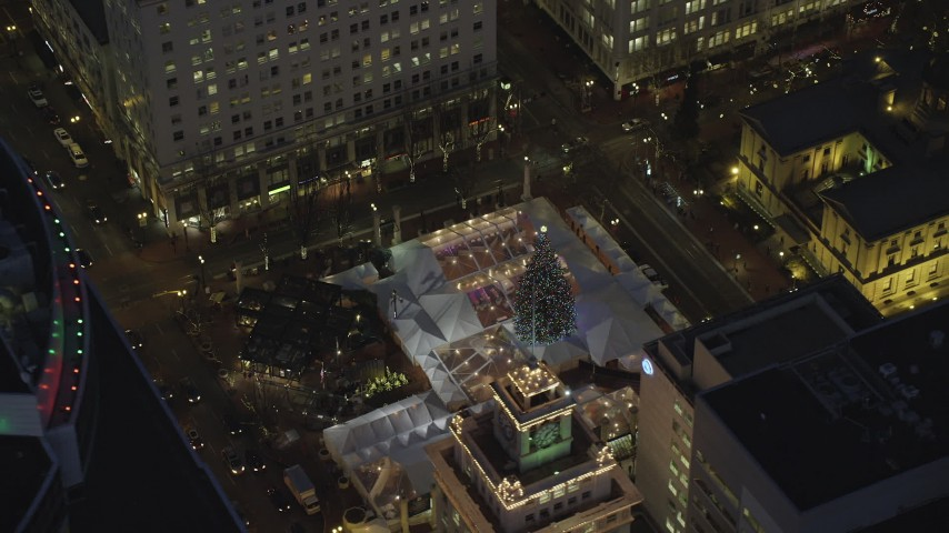 6K stock footage aerial video of a bird's eye orbit Pioneer Courthouse Square, decorated for Christmas, at night in Downtown Portland, Oregon Aerial Stock Footage | AX155_284