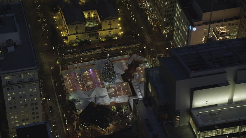 6K stock footage aerial video of a bird's eye orbiting Pioneer Courthouse Square, decorated for Christmas, at night in Downtown Portland, Oregon Aerial Stock Footage | AX155_285