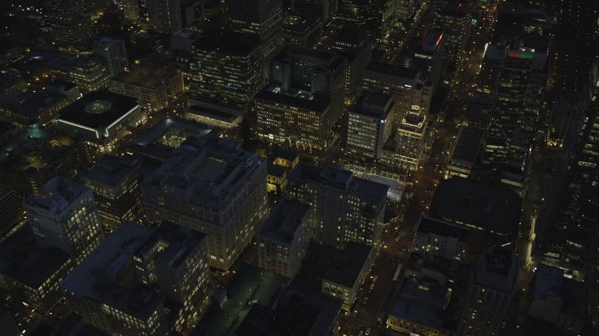 6K stock footage aerial video orbiting downtown to reveal Pioneer Courthouse Square, decorated for Christmas, and Pioneer Courthouse at night in Downtown Portland, Oregon Aerial Stock Footage | AX155_286