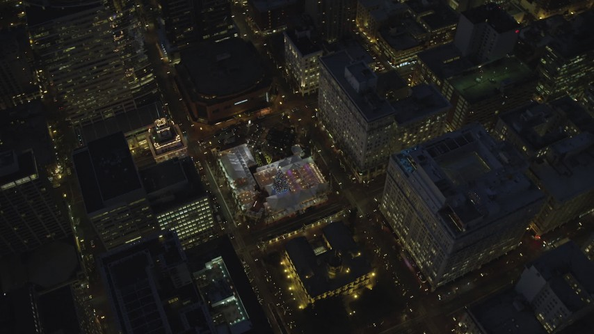 6K stock footage aerial video of a bird's eye of Pioneer Courthouse Square, decorated for Christmas, Pioneer Courthouse, and reveal Hilton Portland at night in Downtown Portland, Oregon Aerial Stock Footage | AX155_288