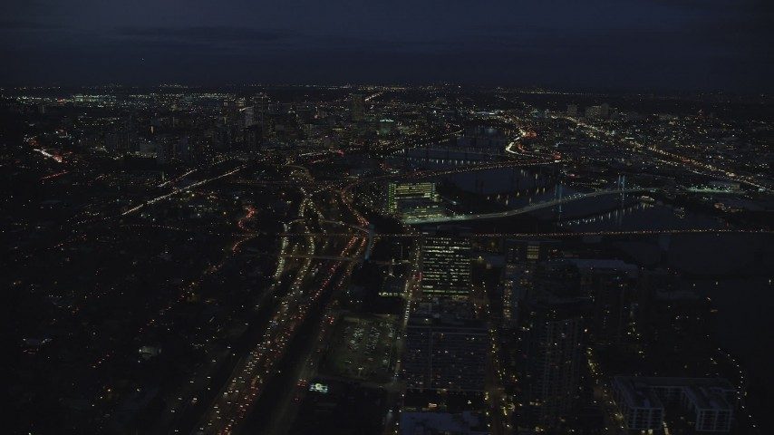 6K stock footage aerial video following I-5 freeway, Downtown Portland cityscape, bridges on the Willamette River at night, Oregon Aerial Stock Footage | AX155_290