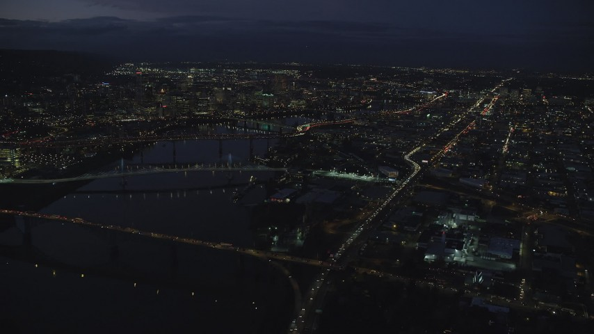 6K stock footage aerial video of Downtown Portland cityscape, bridges on the Willamette River at night, Oregon Aerial Stock Footage | AX155_292
