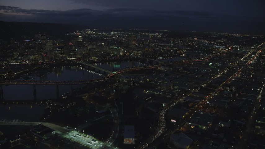 6K stock footage aerial video of Skyscrapers in downtown and bridges across the Willamette River at night, Downtown Portland, Oregon Aerial Stock Footage | AX155_293