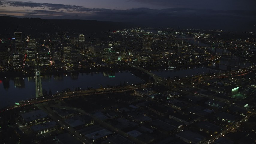 6K stock footage aerial video of skyscrapers in downtown and Willamette River bridges at night, Downtown Portland, Oregon Aerial Stock Footage | AX155_294