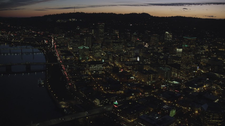 6K aerial video flying over Downtown Portland at night in Oregon toward skyscrapers Aerial Stock Footage | AX155_302