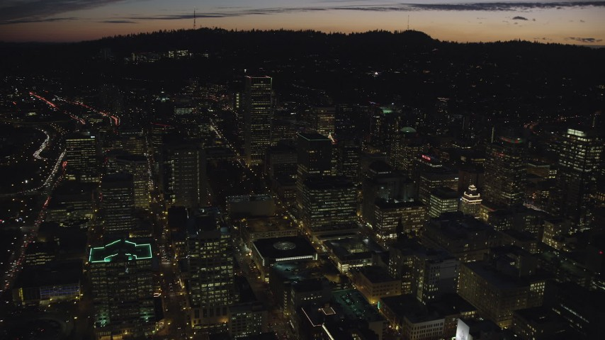 6K stock footage aerial video flying over Downtown Portland at night in Oregon toward Wells Fargo Center Aerial Stock Footage | AX155_303