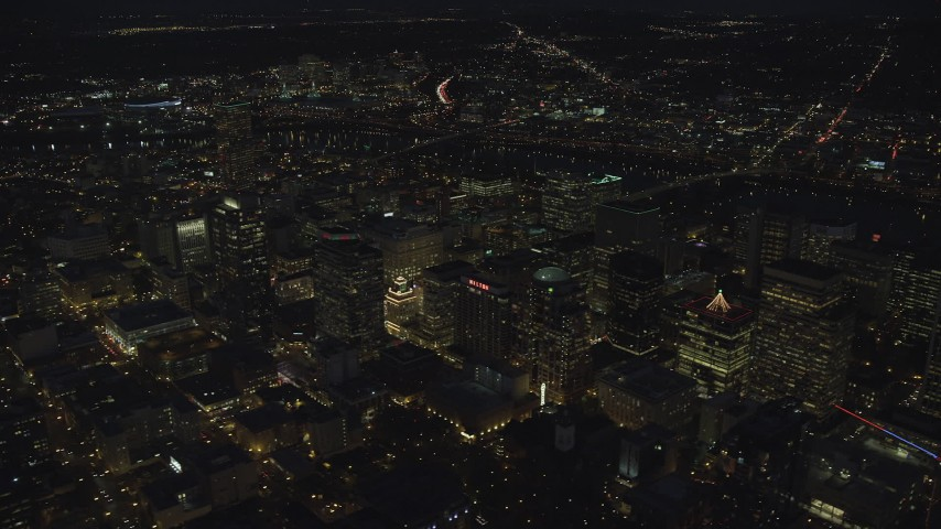 6K stock footage aerial video flying by Park Avenue West Tower and Fox Tower at night in Downtown Portland, Oregon Aerial Stock Footage | AX155_305