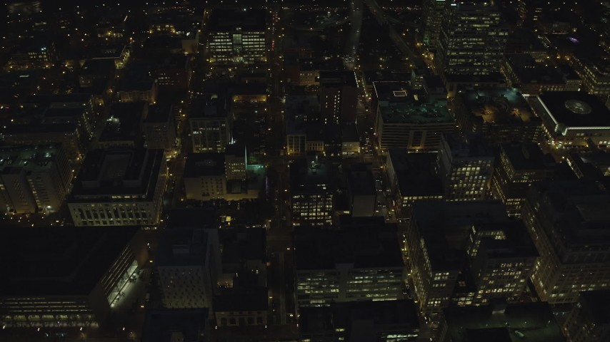 6K stock footage aerial video orbiting of busy city streets in Downtown Portland, Oregon, night Aerial Stock Footage | AX155_307