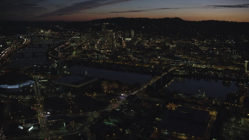 6K stock footage aerial video of Downtown Portland and Willamette River at night seen from Broadway Bridge in Oregon Aerial Stock Footage | AX155_310
