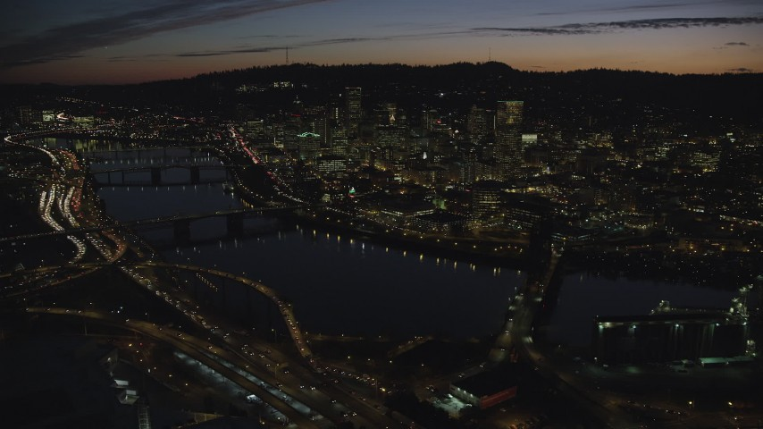 6K stock footage aerial video of a view across the Willamette River of Downtown Portland, Oregon, at night Aerial Stock Footage | AX155_315