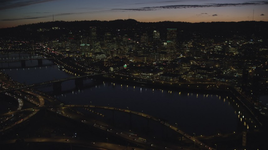 6K stock footage aerial video of a view across the Willamette River of Downtown Portland and the White Stag Sign, Oregon, at night Aerial Stock Footage   AX155_316