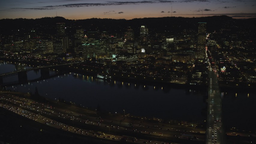 6K stock footage aerial video of Downtown Portland skyscrapers at night seen across the Willamette River, Oregon Aerial Stock Footage   AX155_318