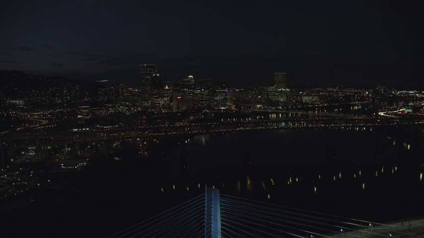 Approach Marquam Bridge and the Downtown Portland city skyline at night, Oregon Aerial Stock Footage | AX155_326