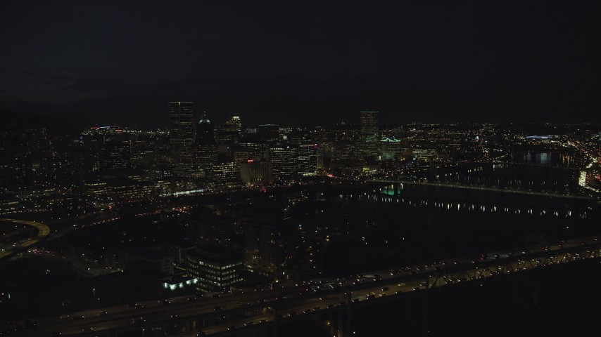 6K stock footage aerial video approaching Downtown Portland at night, Oregon Aerial Stock Footage   AX155_327