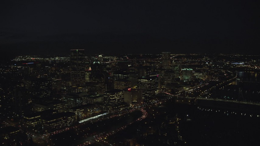 6K stock footage aerial video approaching Wells Fargo Center and KOIN Center at night in Downtown Portland, Oregon Aerial Stock Footage | AX155_328