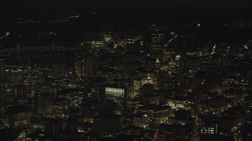 Downtown high-rises and skyscrapers at night, Downtown Portland, Oregon Aerial Stock Footage | AX155_331