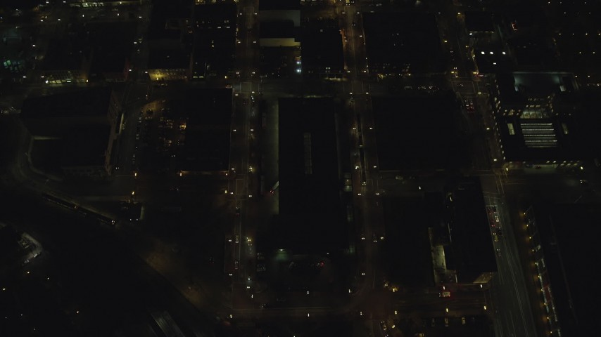 6K stock footage aerial video of a brd's eye view of NW 5th and NW 6th Avenue at night through Downtown Portland, Oregon Aerial Stock Footage | AX155_333