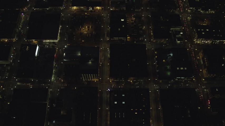 6K stock footage aerial video of a bird's eye view of NW 5th and NW 6th Avenue at night through Downtown Portland, Oregon, reveal US Bancorp Tower Aerial Stock Footage | AX155_334
