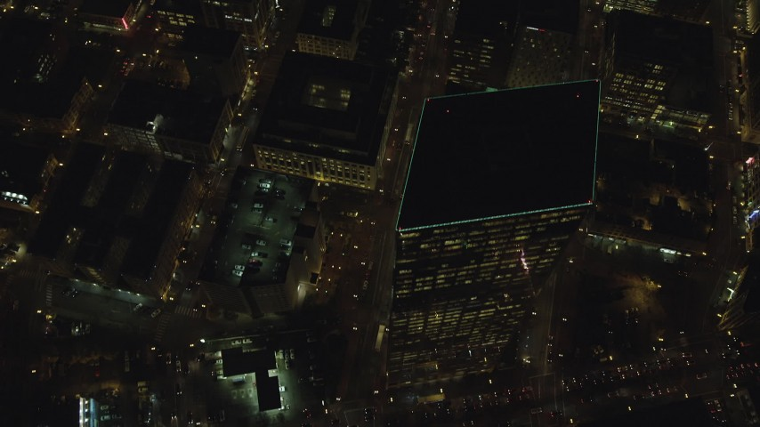 6K stock footage aerial video of a bird's eye view of SW 4th and SW 5th Avenue at night through Downtown Portland, Oregon, reveal US Bancorp Tower Aerial Stock Footage | AX155_335