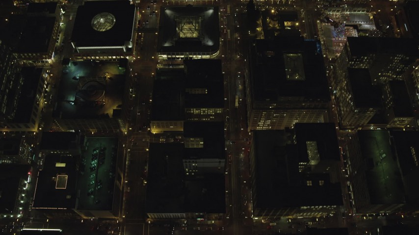 6K stock footage aerial video of a bird's eye of SW 4th and SW 5th Avenue at night through Downtown Portland, Oregon, reveal US Bancorp Tower Aerial Stock Footage | AX155_336