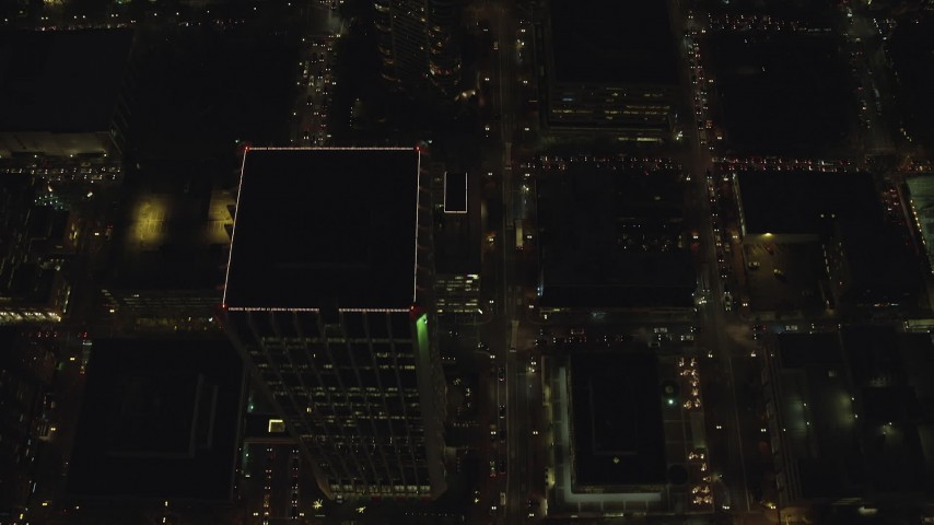 6K stock footage aerial video of a bird's eye of heavy traffic on SW 4th and SW 5th Avenue at night through Downtown Portland, Oregon Aerial Stock Footage | AX155_338