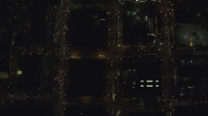 6K stock footage aerial video of a bird's eye of heavy traffic on SW 4th, SW 5th, and SW 6th Avenue at night through Downtown Portland, Oregon Aerial Stock Footage | AX155_339