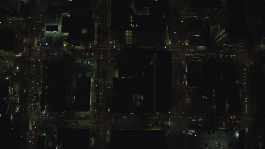 6K stock footage aerial video of a bird's eye of city streets at night through Downtown Portland, Oregon, reveal I-405 and SW Broadway Aerial Stock Footage   AX155_340